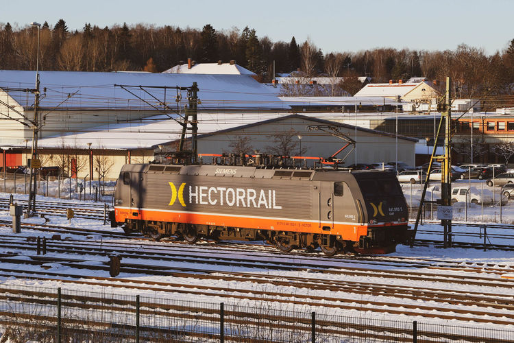 Train on railroad tracks during winter