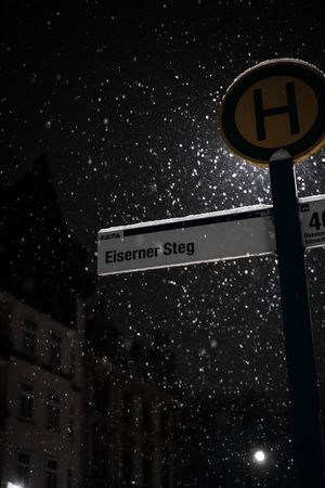 Communication Illuminated Low Angle View Night No People Outdoors Road Sign Snowing Text