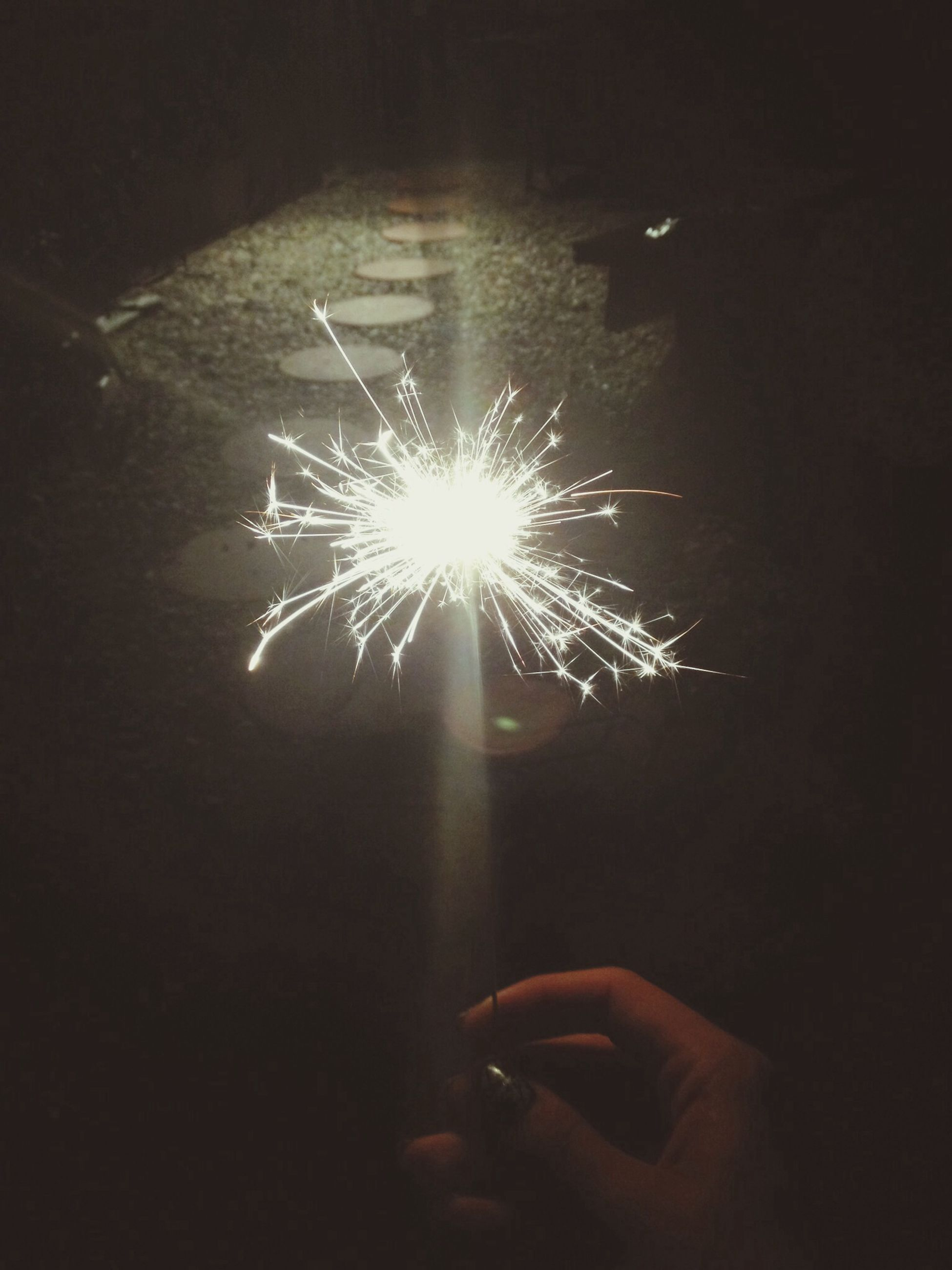 glowing, illuminated, night, person, celebration, fire - natural phenomenon, burning, dark, part of, unrecognizable person, flame, sparks, indoors, light - natural phenomenon, exploding, firework display, lit