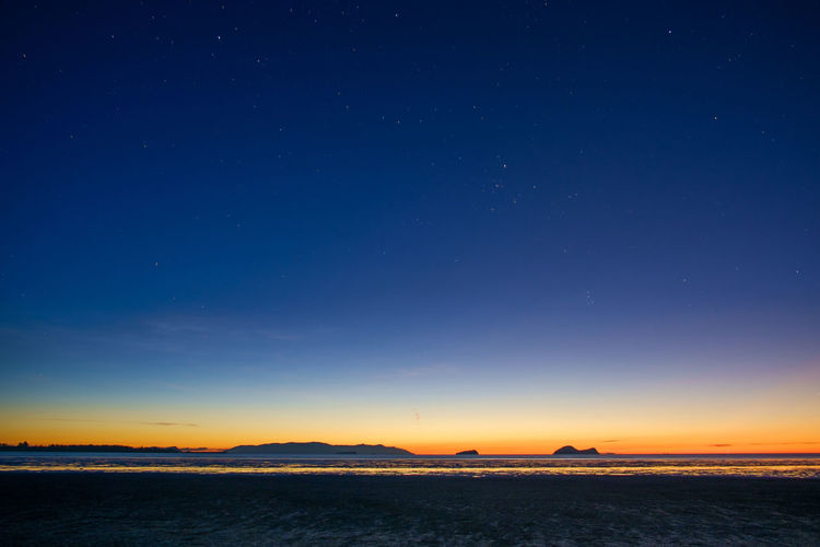 Beach during low tide Astronomy Beauty In Nature Blue Idyllic Land Low Tide Nature Nautical Vessel Night No People Outdoors Scenics - Nature Sea Sky Space Star - Space Sunset Tranquil Scene Tranquility Transportation Water