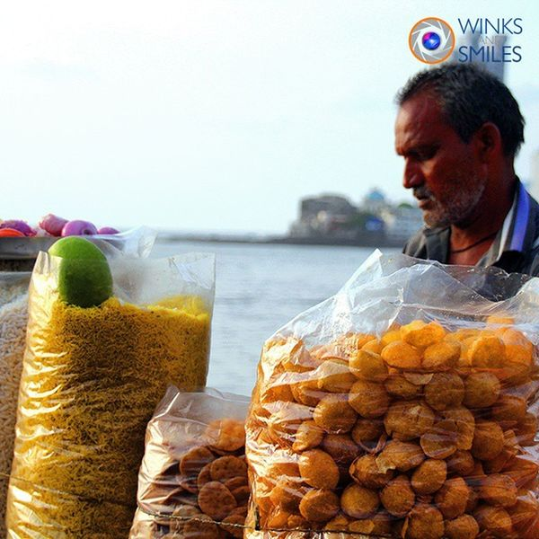 "A 'pani puri' wala (vendor) near Hajiali mosque. The Panipuri also known as Gol gappa is a popular street snack of Mumbai (Bombay). It consists of a round, hollow puri, fried crisp and filled with a mixture of flavored water (""pani""), tamarind chutney, chili, chaat masala, potato, onion and chickpeas. Streetvendor Paanipuri GolGappa Mumbai Camera Indianphotographer Bombay Hajialidargah Mosque Ice Streetsofmumbai Monsoonseason Photographers_of_india RainyDay Instapic Somumbai @streets.of.india Randompic Mumbaikars Mumbaimerijaan Hajialijuicecentre @indiabestpic Streetphotography _soi Aamchimumbai Wassupindia @things2doinmumbai Explorethroughcamera @explore_through_camera"