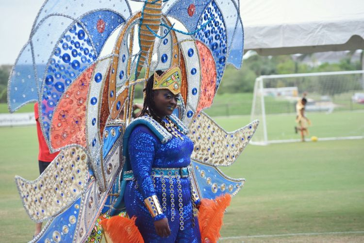 Portrait of woman wearing costume at soccer field