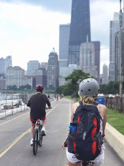 New ways to explore Chicago Chicago City Architecture Building Exterior Built Structure Transportation Rear View #urbanana: The Urban Playground Real People Office Building Exterior Building Men Skyscraper City Life People Mode Of Transportation Riding Day Sky