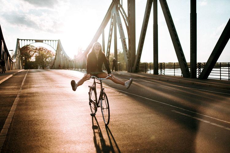 Bicycle on bridge against sky in city