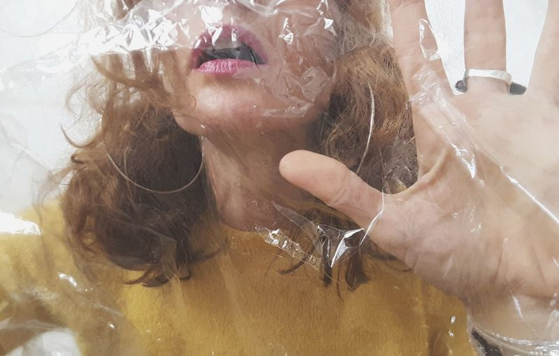 Close-up of woman with plastic