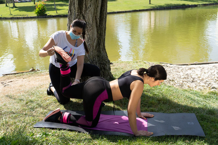 Personal trainer giving a train by the lake