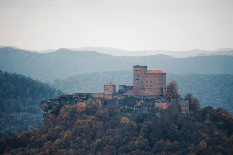 View at Trifels Castle, Palatinate Forest. Trifelsland Pfälzerwald EyeEm Best Shots Mountain Built Structure Architecture Building Exterior Tree Plant Sky Nature Mountain Range Scenics - Nature Building Outdoors Beauty In Nature No People