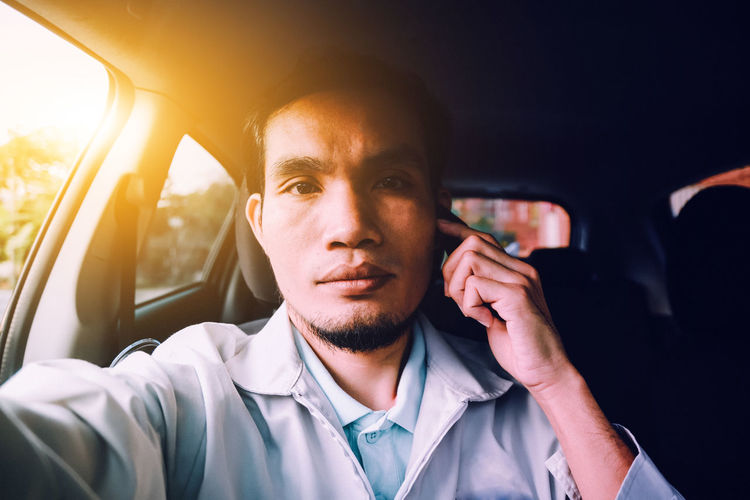 Businessman Car Car Interior Communication Headshot Land Vehicle Lifestyles Men Mid Adult Mid Adult Men Mobile Phone Mode Of Transport One Person Photo Messaging Photography Themes Portable Information Device Selfie Smart Phone Taxi Technology Transportation Travel Using Phone Vehicle Interior Wireless Technology