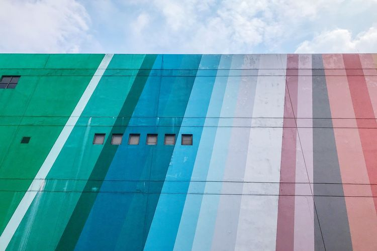 Rainbow color building Built Structure Architecture Building Exterior Sky Cloud - Sky Building Day Residential District Wall - Building Feature Outdoors Low Angle View No People Multi Colored Window City Blue Nature In A Row Pattern Modern
