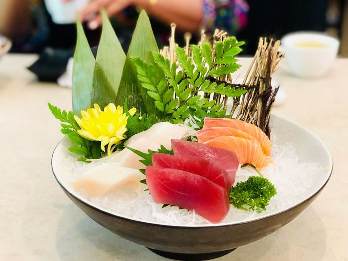 Sashimi Japanese food ready to eat in restaurant Freshness Food And Drink Food Close-up Indoors  Table Focus On Foreground Plate Flower Ready-to-eat Healthy Eating Flowering Plant Seafood Plant Indulgence Japanese Food Serving Size Incidental People Sweet Food Garnish