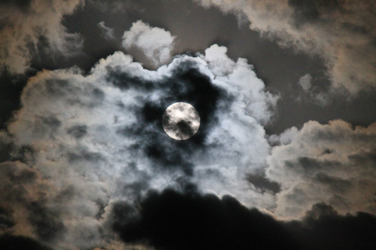 moon, nature, beauty in nature, scenics, cloud - sky, sky, tranquility, astronomy, sky only, tranquil scene, night, no people, moon surface, outdoors, low angle view, space exploration, solar eclipse, crescent, space