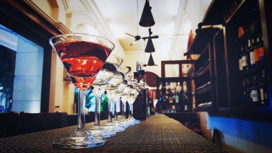 Row Of Martini Glass On Bar Counter