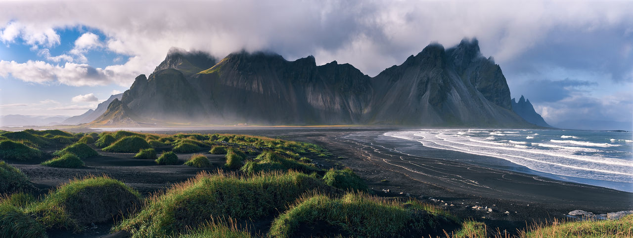 The Vestrahorn in East Iceland FUJIFILM X-T2 Iceland Panorama Stokksnes Beach Beauty In Nature Cloud - Sky Environment Idyllic Land Landscape Mountain Mountain Range Nature No People Non-urban Scene Panoramic Plant Scenics - Nature Sea Sky Tranquil Scene Tranquility Vestrahorn Water