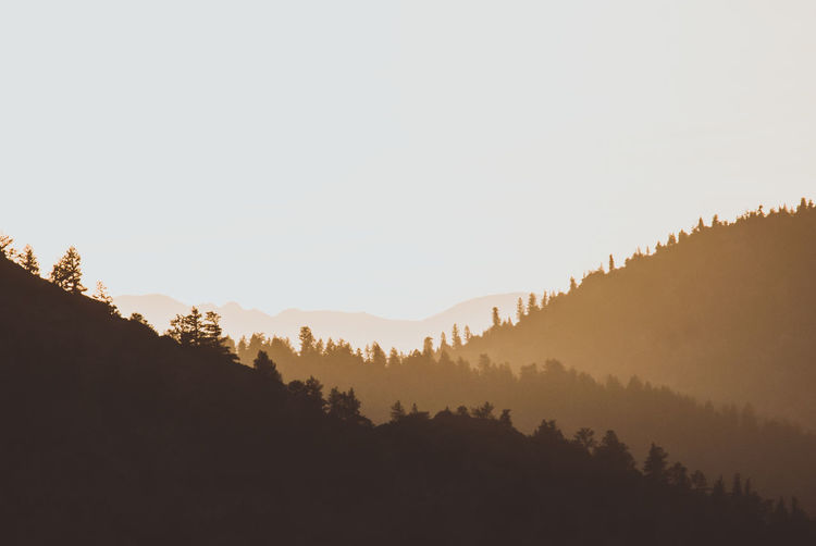 Layers Sunset Silhouettes Beauty In Nature Canyon Clear Sky Colorful Copy Space Day Hazy  Landscape Mountain Mountains Nature No People Outdoors Scenics Silhouette Sky Sunset Tranquility Tree