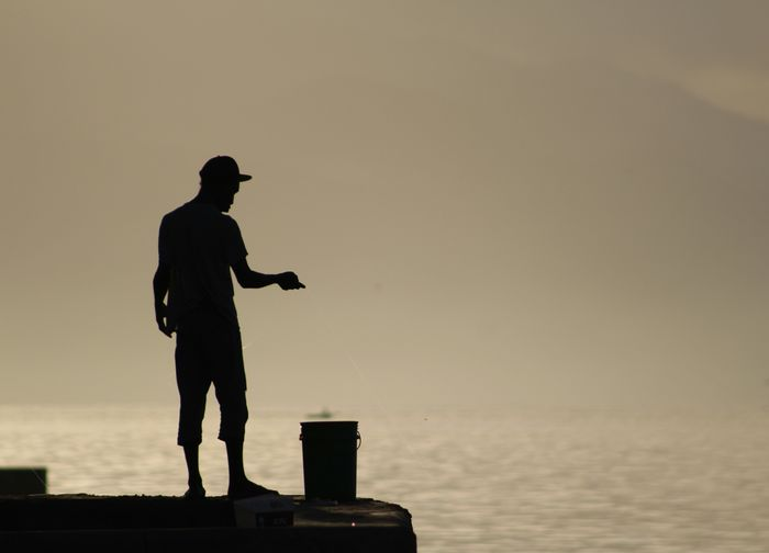 Silhouette Man Against Calm Sea