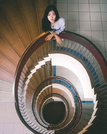Adult Architecture Architecture_collection Built Structure Colours Day Full Length High Angle View Indoors  Leisure Activity Lifestyles Looking Up One Young Woman Only People Portrait Portrait Of A Woman Portraits Railing Spiral Staircase Staircase Steps Steps And Staircases Women Young Adult Young Women