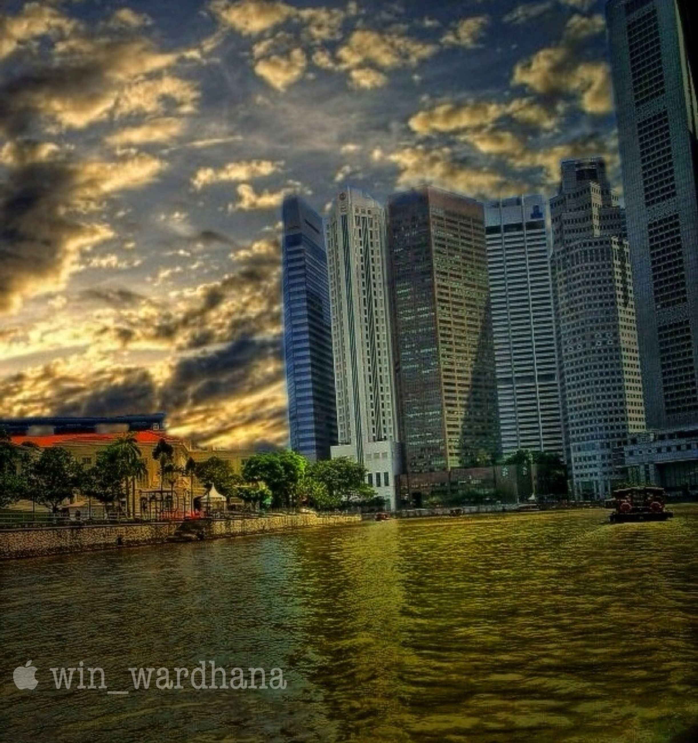 building exterior, architecture, built structure, city, sky, water, skyscraper, cloud - sky, cityscape, tall - high, modern, waterfront, building, tree, office building, residential building, river, tower, cloudy, outdoors