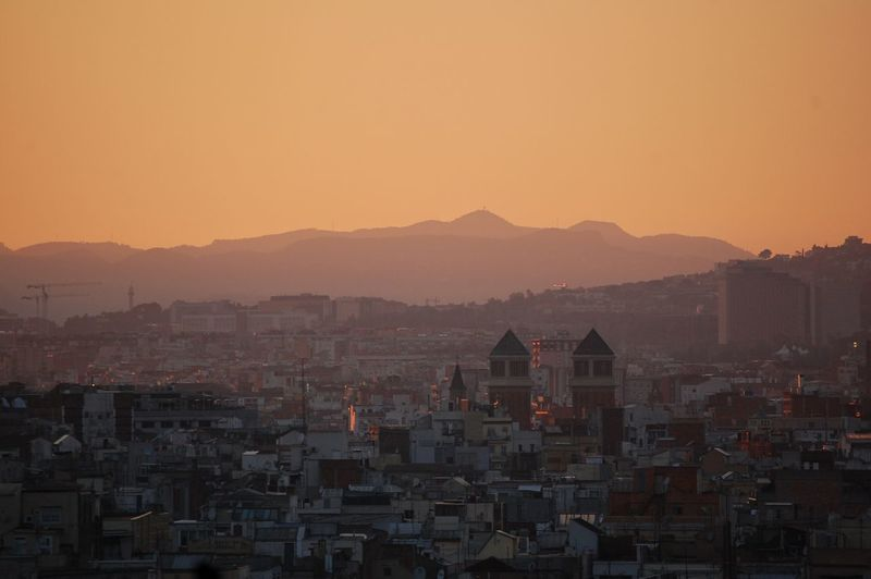 High angle shot of townscape against orange sky
