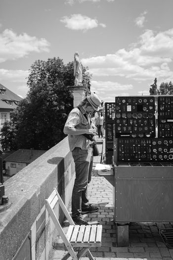 Prep City City Life Man Prague Black And White Blackandwhite Bridge Built Structure Canon Canonphotography Casual Clothing Day Full Length Jewelry Men Monochrome One Person Real People Sky Standing Street Street Photography Street Seller Streetphotography Working