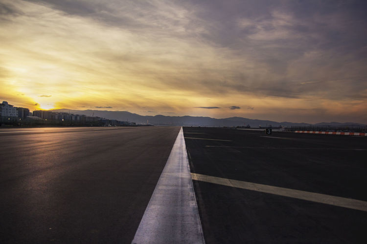 Airport Airport Runway British Course Gibraltar Gibraltar Is British Gibraltar Landscape No People Outdoors Path Pathway Runway Sky Sun Sunset The Way Forward Track Tracks Urban Skyline
