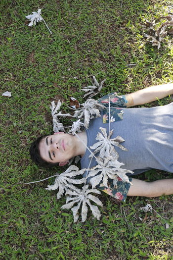 Day Grass High Angle View Lifestyles Looking At Camera Lying Down One Person Outdoors People Portrait Real People Young Adult Young Women