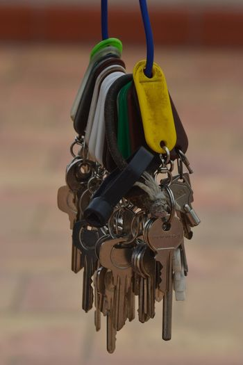 Close-up of keys hanging on wire