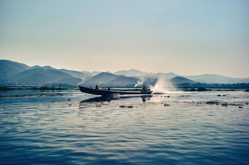 Water Mountain Transportation Nautical Vessel Mode Of Transport Nature Scenics Beauty In Nature Reflection Outdoors Mountain Range Sea Sky No People Day Burma Myanmar Inle Lake An Eye For Travel