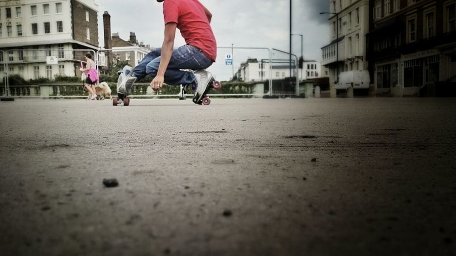 Low section of boy with roller skate on street