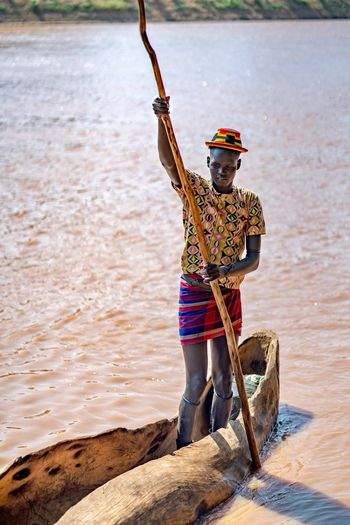 Tribe Dassanech Tribe Dassenach Tribal Ethiopian Photography 🇪🇹 Dassanech Tribe Ethiopian Ethiopia Portrait River Omo River Omo Valley Omorate Water One Person Real People Nature Land Full Length Day Occupation Standing Working Outdoors Adult Holding Sunlight Clothing River Flowing Water