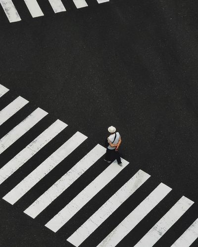 High angle view of person crossing road