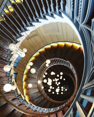 Spiral staircase with a twist Creative Architecture Architecture Artistic Wood Spiral Staircase Artificial Light Lightning Indoors  No People High Angle View Design Directly Above Architecture Spiral Staircase Circle Art And Craft Ornate