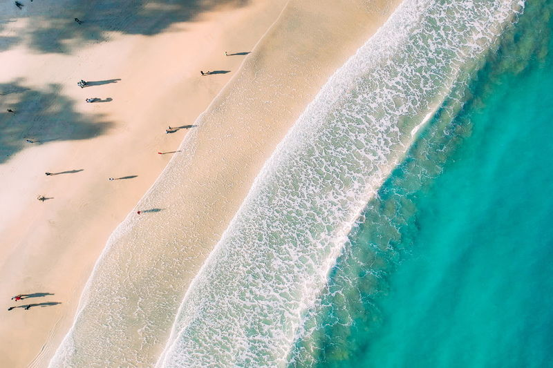 Water Land Sea Nature Day Beauty In Nature Sport Motion Beach Scenics - Nature No People High Angle View Aerial View Aquatic Sport Outdoors Wave Sand Sunlight Speed Swimming Pool Turquoise Colored