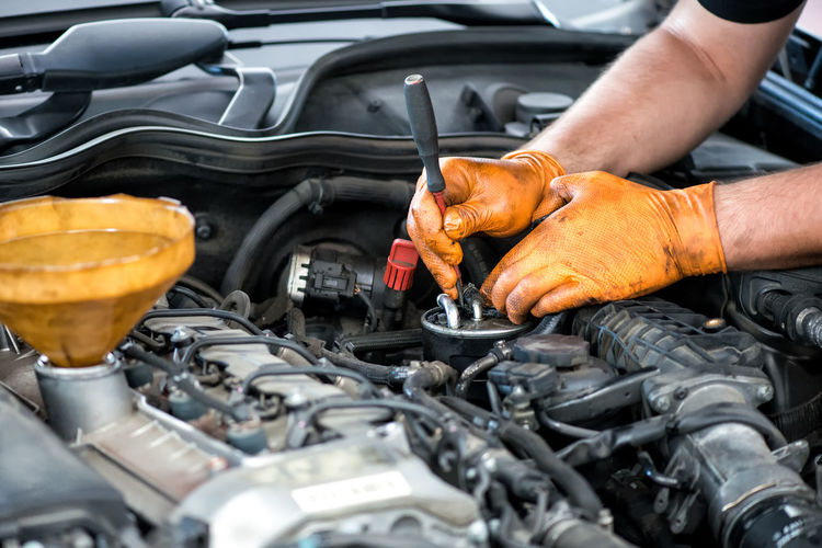 Mechanic working on a diesel filter, close up Cars Mechanic Working Auto Repair Shop Automobile Industry Automotive Car Engine Engineering Garage Maintenance Mechanic Repair Repairing Service Stationary Tool Trade Vehicle