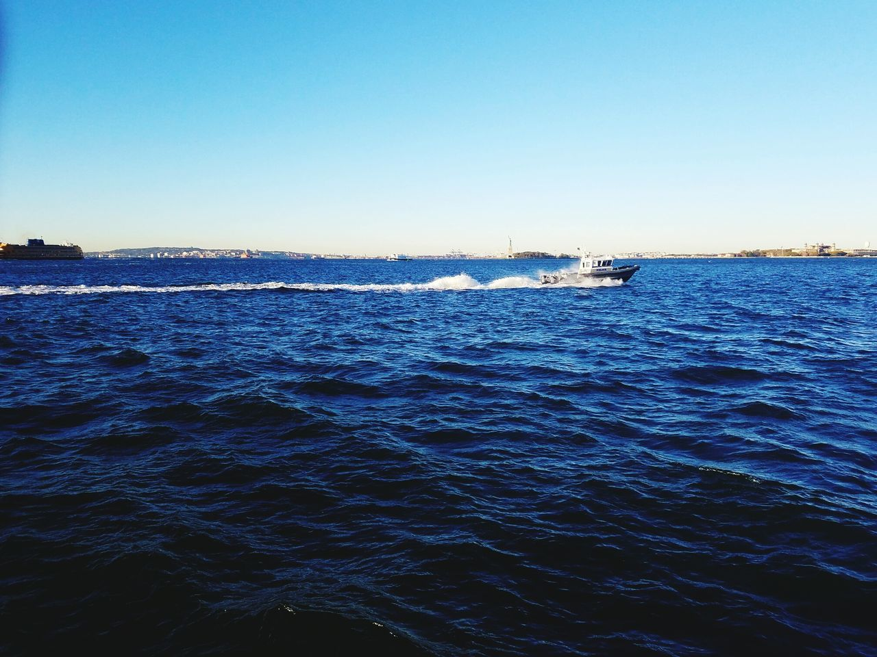 sea, water, nautical vessel, waterfront, nature, outdoors, transportation, blue, clear sky, no people, day, mode of transport, wake - water, beauty in nature, sailing, wave, sky, jet boat