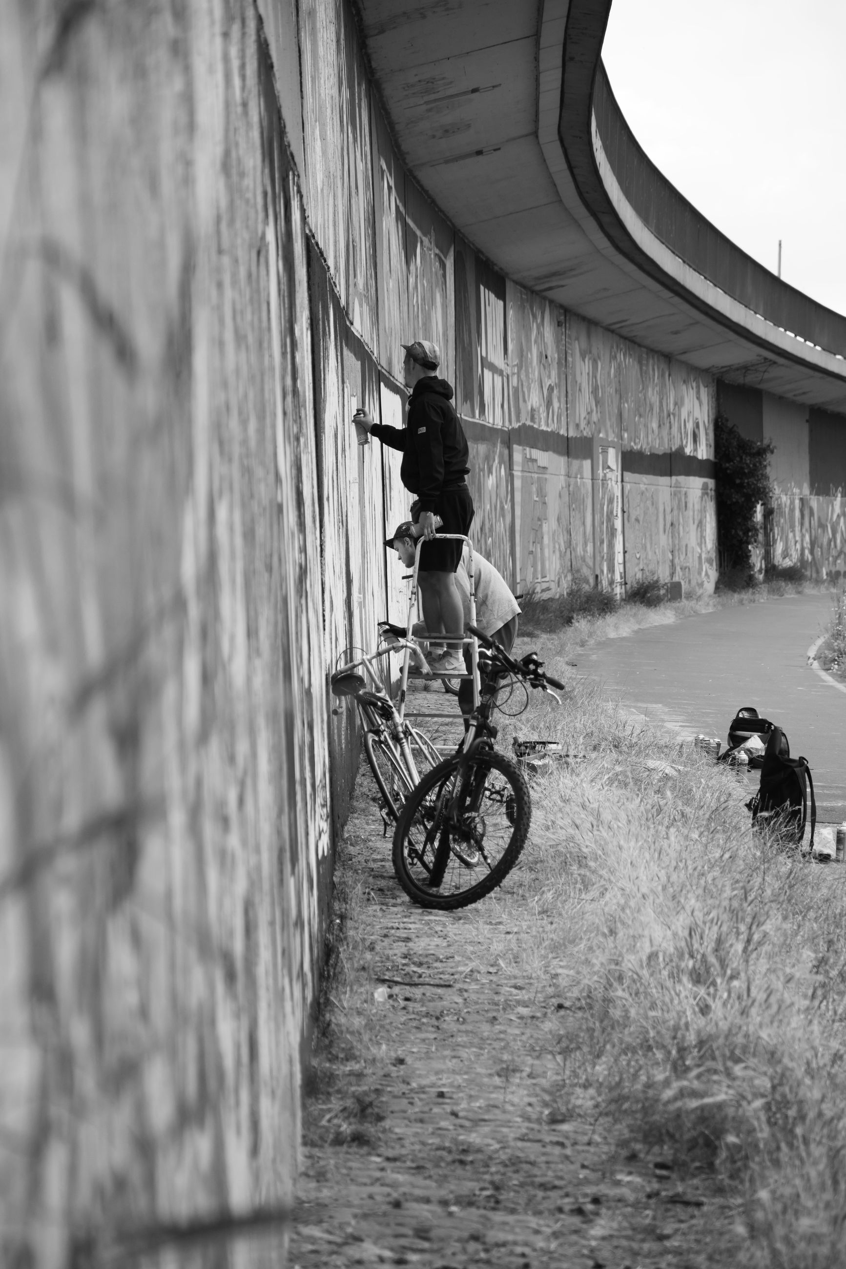 MAN RIDING BICYCLE ON MOTORCYCLE