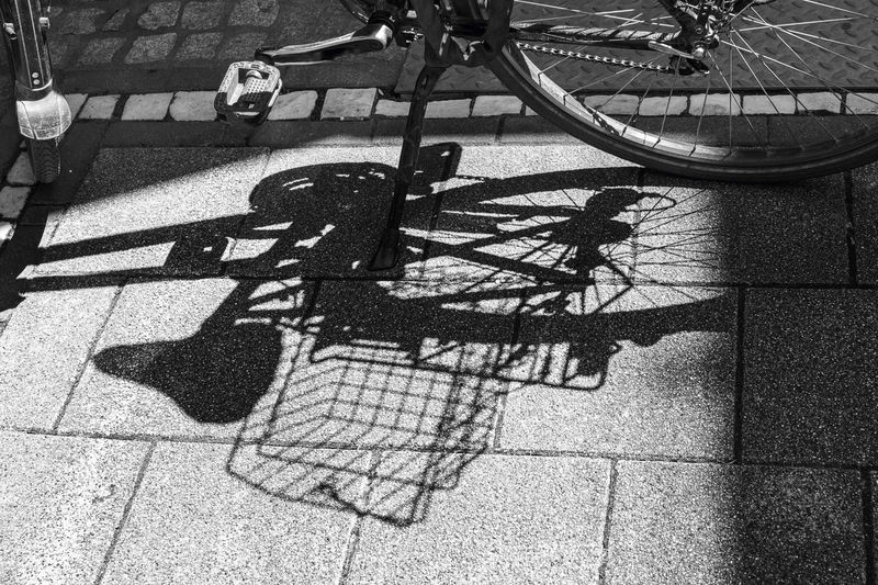 High angle view of shadow of bicycle on street