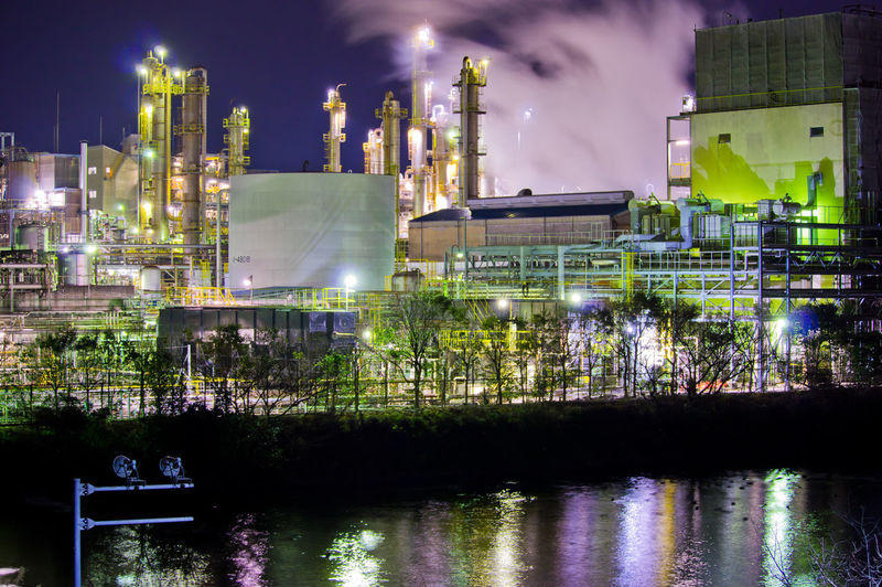 Building Exterior Factory Architecture Industry Built Structure Water Smoke Stack Night Fuel And Power Generation Illuminated Industrial Building  Sky Reflection Waterfront No People Environmental Issues Outdoors Smoke - Physical Structure Pollution Cooling Tower Chemical Plant Air Pollution Industrial District Japan Japan Photography