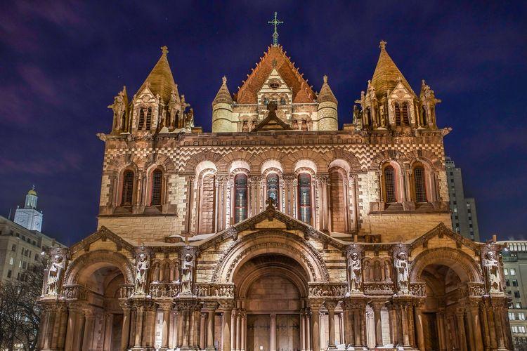 Low Angle View Of Illuminated Trinity Church Against Sky