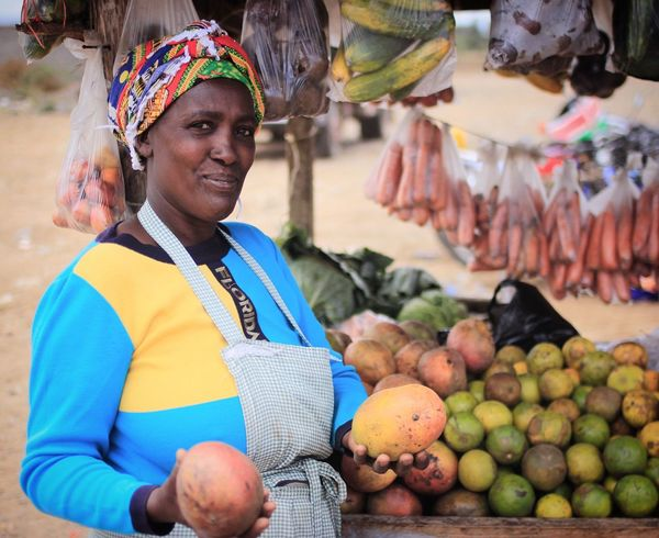 Miriam sells the best Mangoes and Avocado's in town Vegetables Fruits Fresh Produce Market Stall Outdoors Market Smiling Freshness Variation Healthy Eating Food Day One Person Adult People Localproduce EatLocal African Africanstall Africanmarket AfricanFood