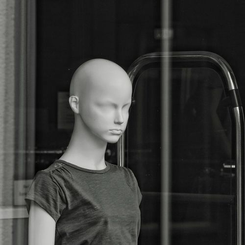 Mannequin seen through store window