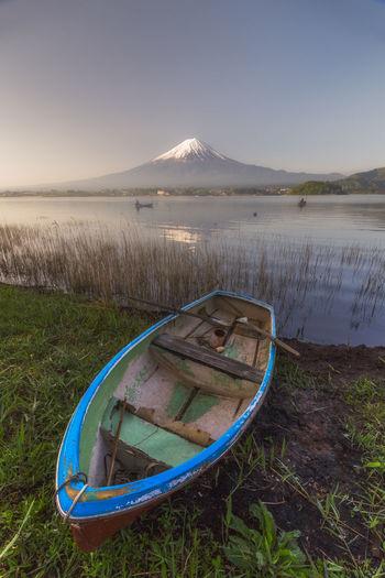 Boat Moored By Lake Against Mt Fuji