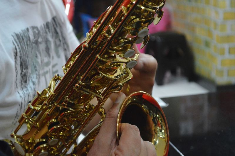 Midsection Of Saxophonist Playing Saxophone