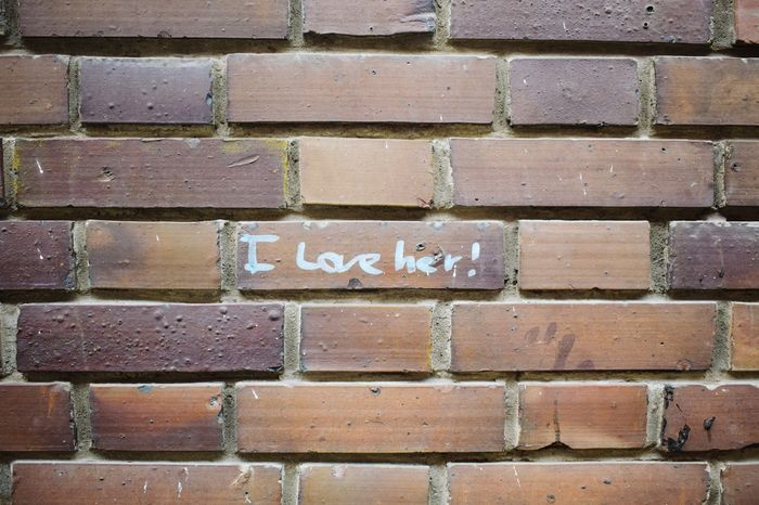 Full Frame No People Close-up Backgrounds Day Outdoors Street Streetphotography Text Wall Brick Brickwall Iloveher White Love The Street Photographer - 2017 EyeEm Awards