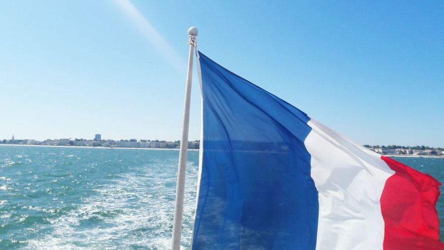 France 🇫🇷 Water Blue Sunny Sky Flag Clear Sky Outdoors No People Sea Day Ocean Cap Ferret Dune Du Pyla Dune Du Pilat Your Ticket To Europe