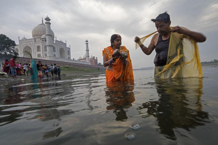 People on water against sky
