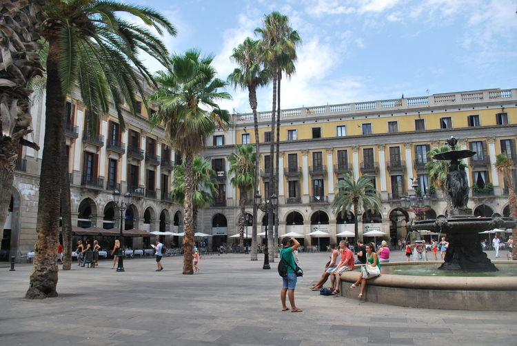 Adult Adults Only Architecture Barcelona Barcelona, Spain Catalonia Catalunya City Day Fountain Outdoors Palm Tree People SPAIN Square Travel Destinations Tree Walking