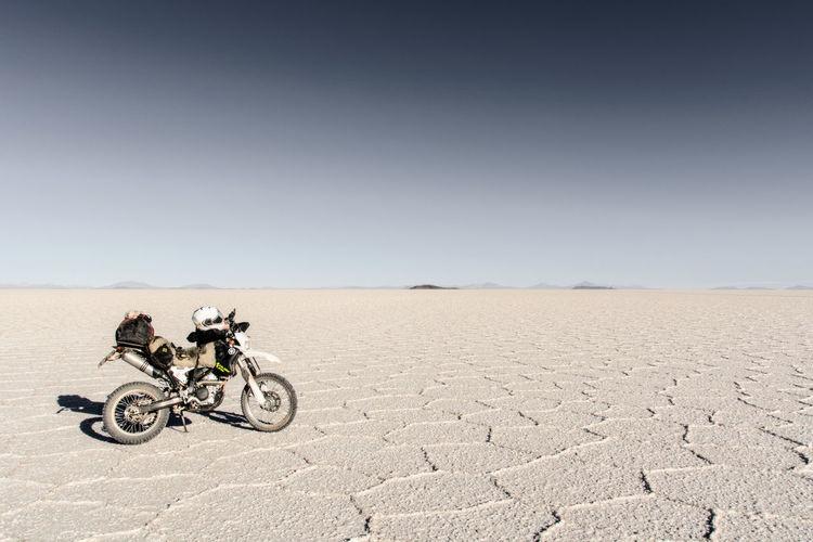 Man riding bicycle on desert