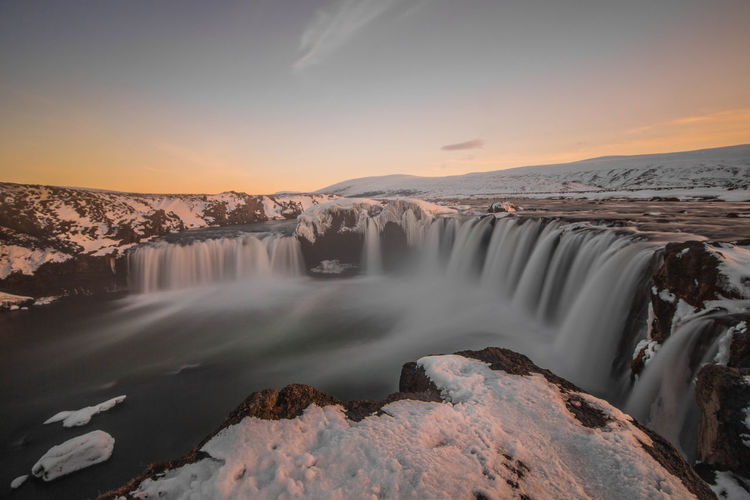 Godafoss Beauty In Nature Blurred Motion Environment Flowing Flowing Water Idyllic Landscape Long Exposure Motion Mountain Nature No People Non-urban Scene Power In Nature Rock Scenics - Nature Sky Tranquil Scene Tranquility Water Waterfall The Great Outdoors - 2018 EyeEm Awards