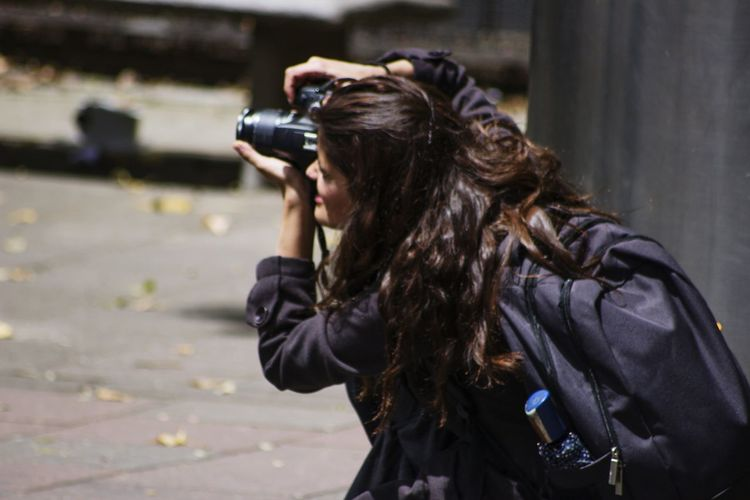 Woman Photographing With Camera
