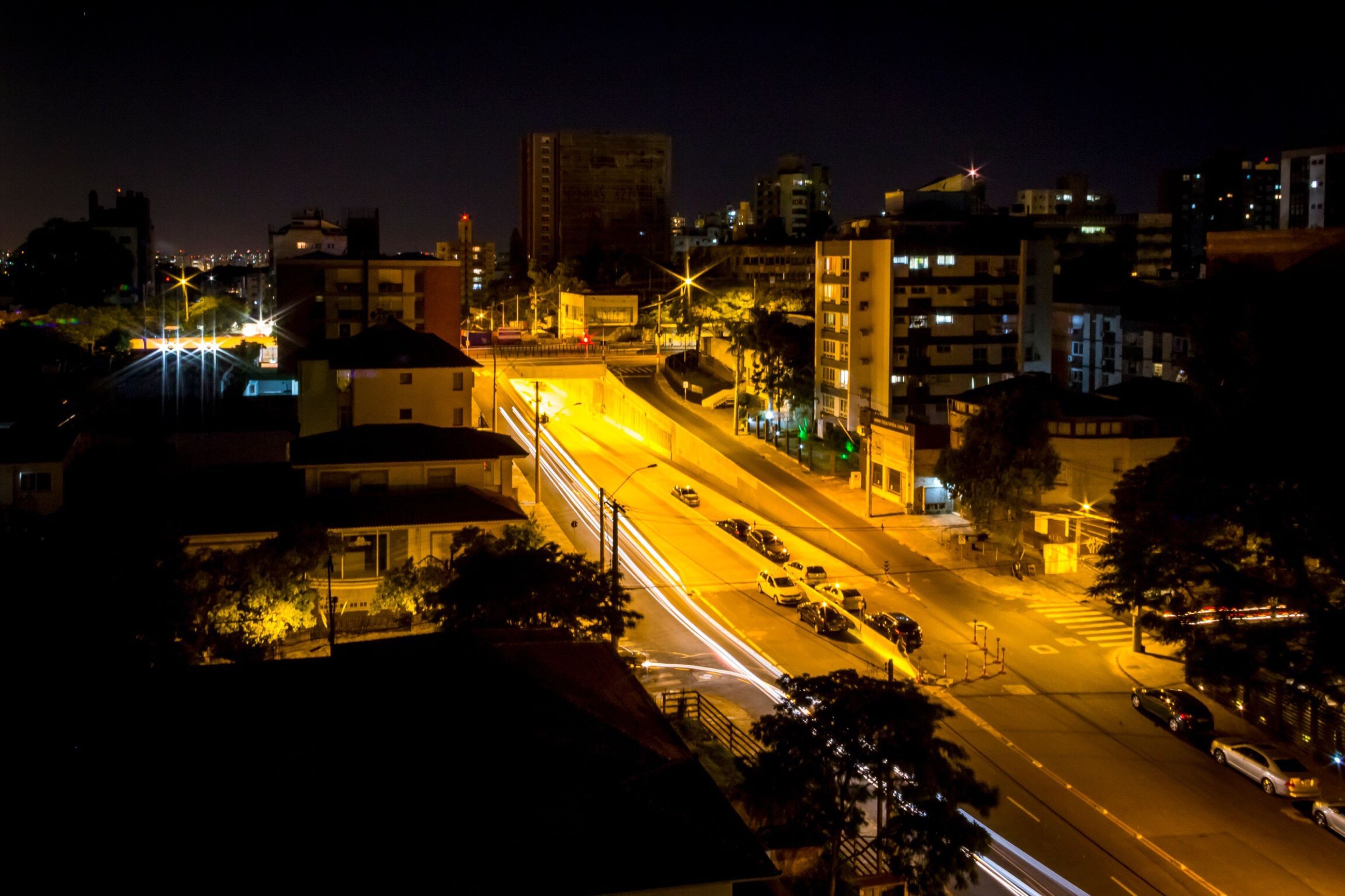 night, city, illuminated, high angle view, transportation, building exterior, street light, cityscape, city street, city life, architecture, traffic, outdoors, built structure, road, no people, urban road, sky, nightlife, skyscraper